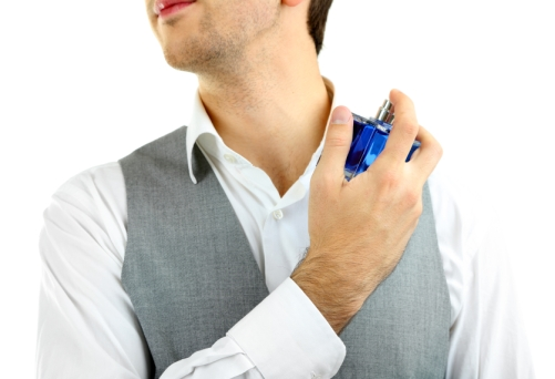 Handsome-young-man-using-perfume-isolated-on-white.jpg