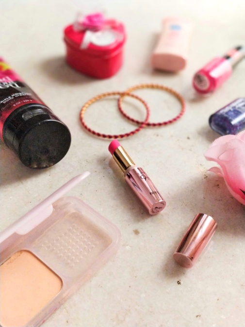 A flatlay of the lakme primer lipstick Fuchsia File